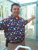 Mike Wilton poses for the camera behind the Disney\'s California Adventure attraction The Maliboomer.