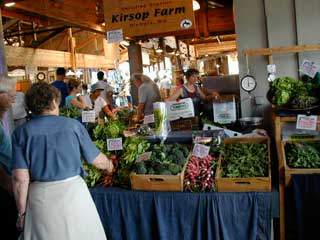 Shoppers browse locally grown produce at a Farmers Market in Washington